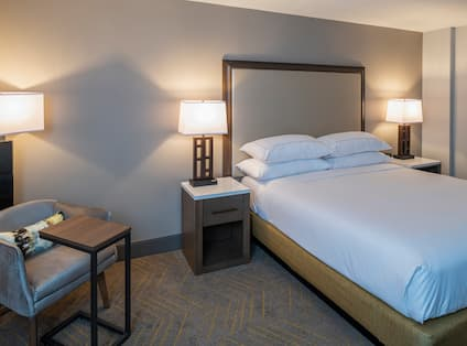 Guest Room with Large Bed and Seating Area