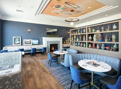 Audrey Kitchen and Bar with Soft Seating in Blue and White Tones