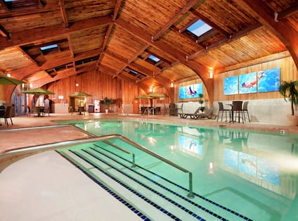 Indoor Pool Area with Hot Tub and Sauna