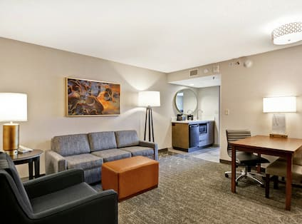 Suite Living Area with Wet Bar and Work Desk