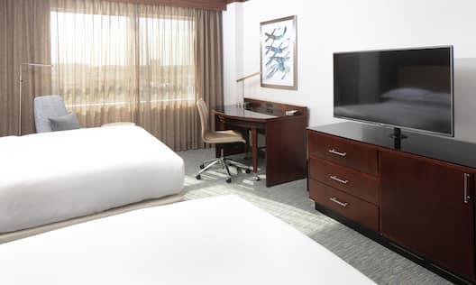 Guest Room with 2 Queen sized Beds Desk and TV