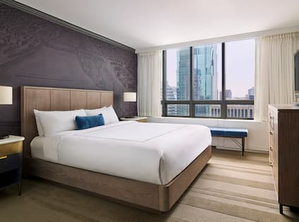 Suite Bedroom with Bed, Television and Outside City View