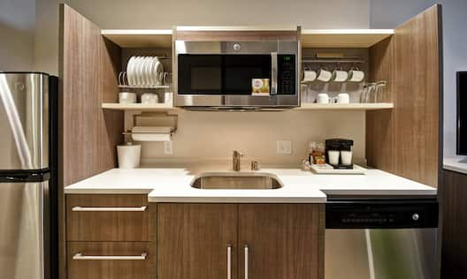 Suite Kitchenette with Fridge, Microwave, Coffee Maker, and Dishwasher