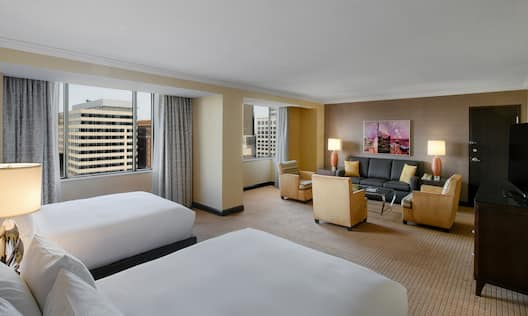 Deluxe Junior Suite with Two Queen Beds, Television, Lounge Seating and Outside View