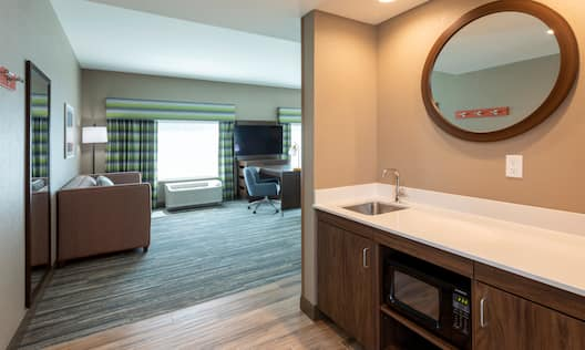 sink with mirror and couch