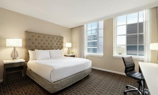 King Bedroom with Large Windows and Desk Area