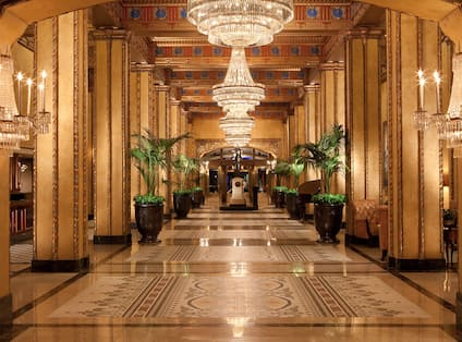 Lobby - Wide Hallway with Columns and Chandeliers
