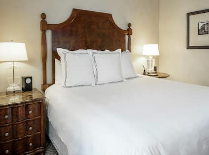 Bed in room with chest of drawers