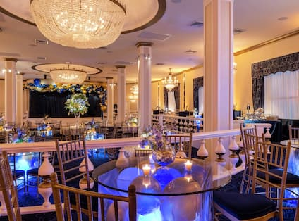 Blue Room Event and Meeting Space with Elegant Lighting Fixtures and Decor