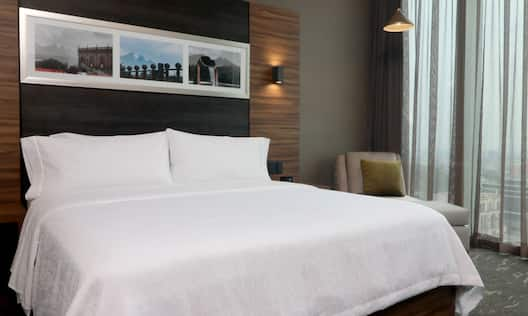 close up of queen bed in guest room