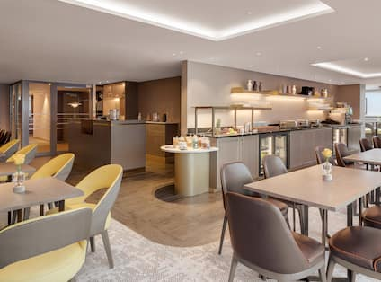 Executive Lounge with Four Tops and Seating, Buffet Area and Beverage Station