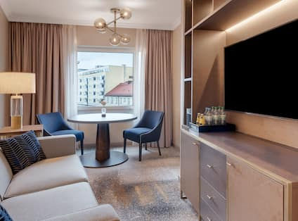 Twin Junior Suite Living Area, TV, Dining Table and Chairs, Plus Window with Outside View