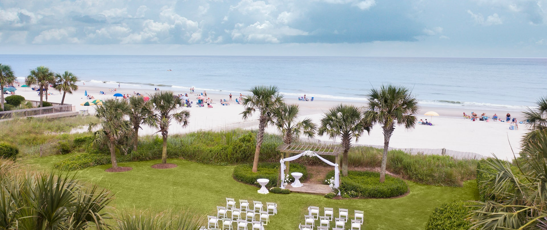 Outdoor Wedding Venue on Lawn with Beach View
