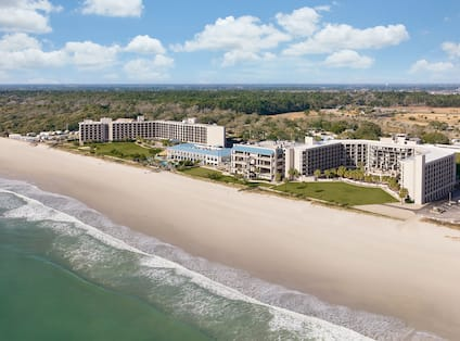 Panoramic View of Beach and Hotel Building at Daytime
