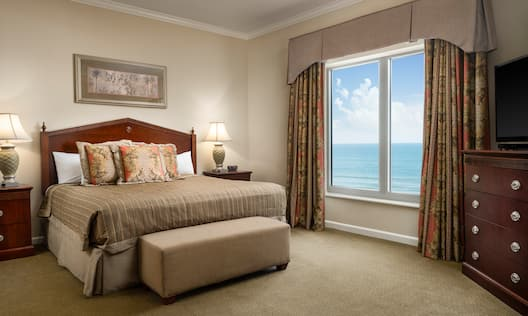 Guest Room with Large Bed and Beach View