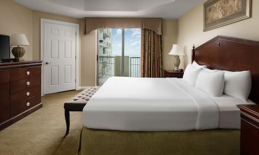 Guest Room with Large Bed and Private Balcony