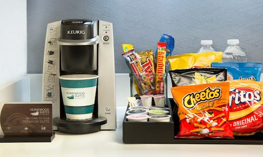 Hospitality Center With Keurig, Candy, Chips and Bottled Water