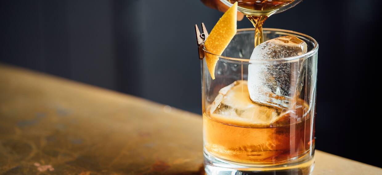 Whiskey being poured into Whiskey Glass