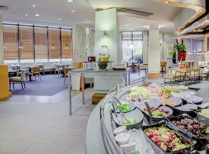 Mason's Restaurant Breakfast Area with Fresh Fruit and Juices on Counter