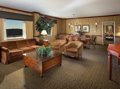 Suite Living Area with Couch, Armchairs, Table, Chairs, Room Technology, and Outside View