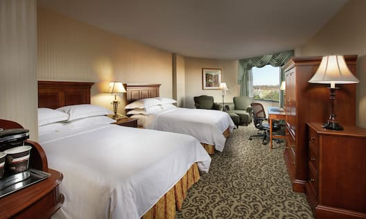 Doubles Guestroom Deluxe with Two Beds, Lounge Area, Work Desk, and Outside View