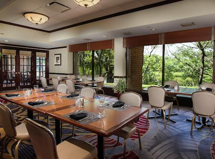DoubleTree Hotel Restaurant with Tables, Chairs, and Outside View