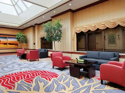 DoubleTree Hotel Prefunction Area with Armchairs, Tables, and Couches