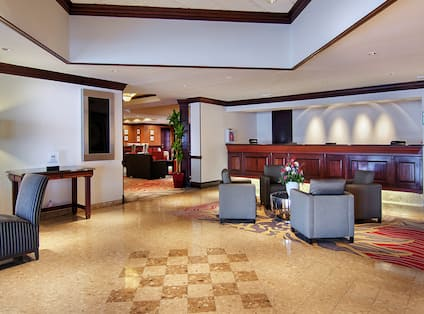DoubleTree Hotel Lobby with Tables, Chairs, and Armchairs