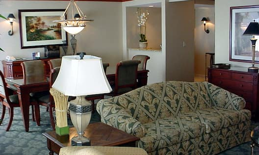 Parlor Suite Living Area with Sofa, Table, Chairs, and Lounge Area