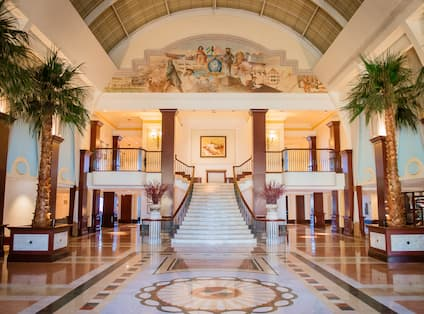 a hotel lobby with a grand staircase