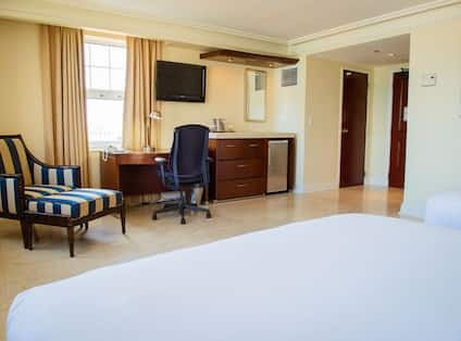 Guestroom with Two Beds, Work Desk and Television