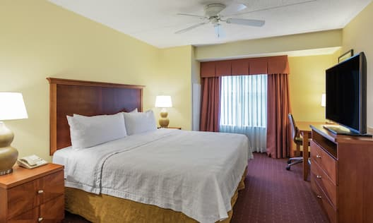 Guest Room Suite with King Bed, HDTV, and Work Desk