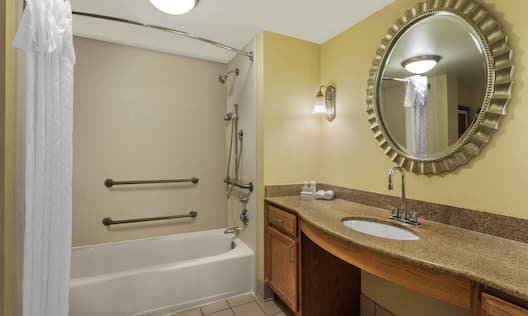 Accessible Guest Bathroom with Tub and Vanity