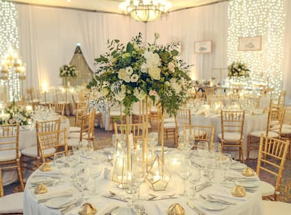 Event Setup with Table and Chairs and Flower Central Piece