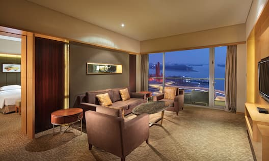 Suite Living Area with Large Windows and River View