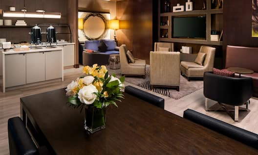 Refreshment Station, Soft Seating, Table with Flowers and Chairs in Executive Lounge