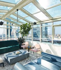 Atrium with Glass Ceiling in Guest Room with Panoramic City View