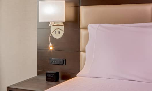 Nightstand with Lighting and Outlets for Plug-in Devices