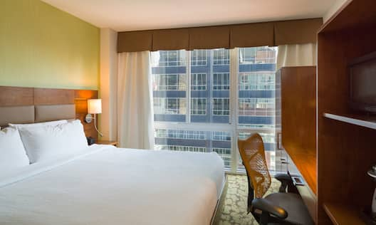 King Bed, Illuminated Lamp, Floor-to-Ceiling Window With Open Drapes, Work Desk, and Hospitality Center