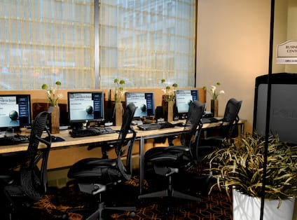 Business center with computers and office chairs