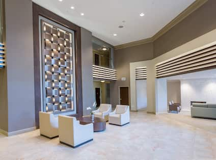 Angled View of Lounge Seating by Art Feature in Main Lobby