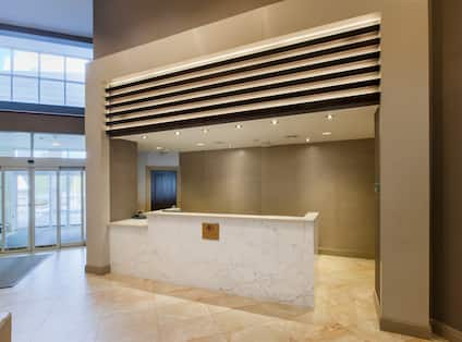 Reception Area With View of Glass Door Entrance and Front Desk