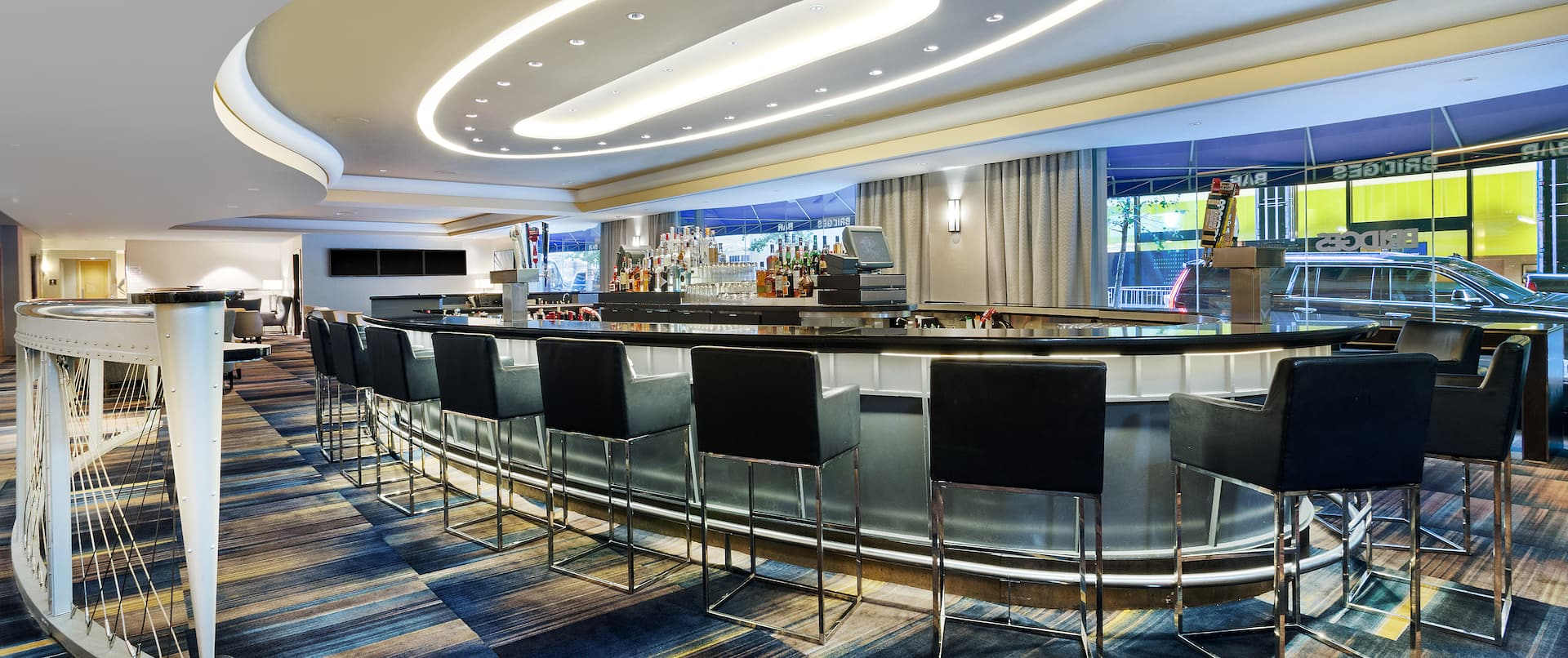 Bridges Bar in Oval Setting with Black Chairs