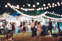 A blurred out shot of an outdoor gathering at night.