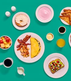 Breakfast dishes set against a blue-green background