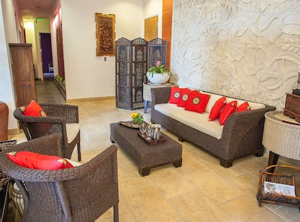 Tables and Guest Seating in Reception Area of Spa Gaia