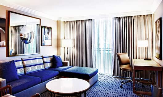Guest Suite Lounge Area with Sofa, Coffee Table and Work Desk