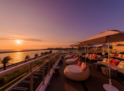 Rooftop Bar Area at Sunset Overlooking the Water