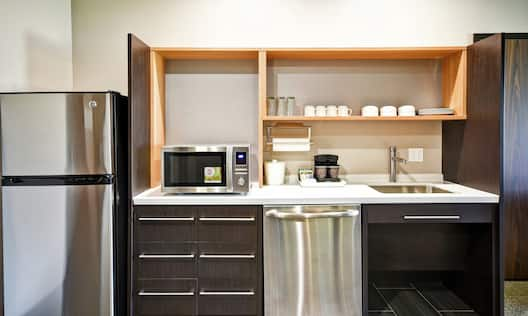 Kitchen Area with Dishware and Stainless Steel Appliances