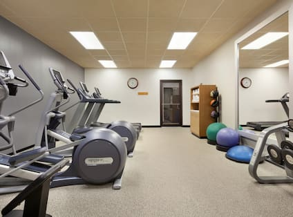 Fitness Center for Guests With Cardio Equipment, Towel Station, Weight Balls, Exercise Balls, and Free Weights